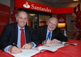 Luis Juste, area director UK and Portugal, Santander Universities, and Vice Chancellor Nigel Thrift sign the papers