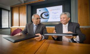 Professor Lord Kumar Bhattacharyya (right) and Professor D. Acharya, Director of IIT Kharagpur  (left) sign agreement