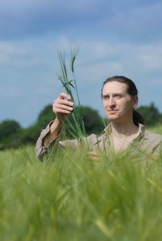 Professor Robin Allaby, University of Warwick in a field of barley