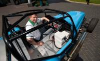 Research engineer Stephen Lambert with the hybrid kit car at the University of Warwick