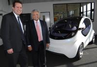 Professor Lord Bhattacharyya (right) and Nick fell (left) with the Pixel car