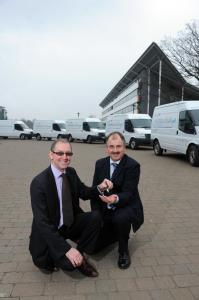 Director of Estates Bob Wilson and Transport Manager Graham Hine with the five new Ford Transit electric vans