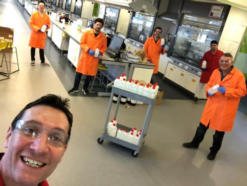 University of Warwick Department of Chemistry researchers on completion of their first batch of sanitiser - In background From left to right: Qiao Song, Arkadios Marathianos, Stephen Hall, Atty Shegiwal and Professor Dave Haddleton. Foreground Professor Seb Perrier