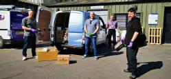 Left to right University of Warwick Chemistry stores manager Steve Dawson; Neil Gillespie, Senior Civil Engineering Technician School of Engineering; Alan Warwood Head of Facilities in Estates;  & Kevin Murphy Chemistry Core technician with one of the loads of PPE supplies delivered to UCHW