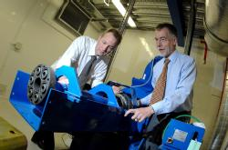 Mark Amor-Segan and Chris Bale (L-R) examine the hybrid powertrain test facility