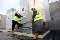Director of Estates Bob Wilson and Dan Persaud, director of student support and residential life, help install the first environmentally friendly bathroom pod in the new hall of residences on the University of Warwick campus