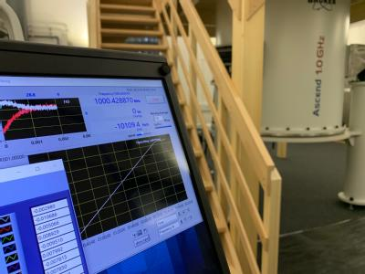 Console display showing the new NMR spectrometer (in the background) generating a 1 GHz magnetic field.