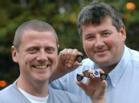 Dr Kerry Kirwan and Dr Steve Maggs woth Blue Peter Badges