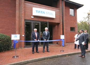 Hans Fischer at ribbon on right. Professor Lord Kumar Bhattacharyya, Chairman of WMG at ribbon on left. Debashish Bhattacharjee is watching just off the pavement on the right of the photo.