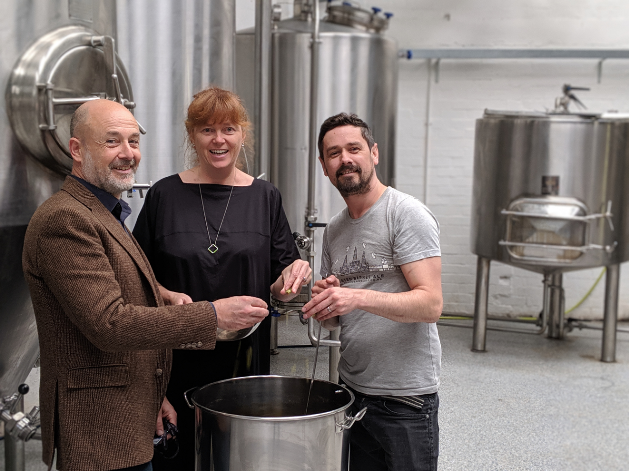 (L-R) Dr Shaun Hides (Coventry University),  Professor Jackie Hodgson (University of Warwick) and Ritchie Bosworth (Twisted Barrel Ale) prepare the Colla-beer-ate beer that will be exclusively, and only, on sale at the event.