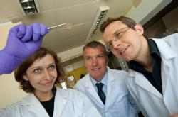 Chemistry PhD student Helena Stec with some ultra-thin gold film, watched by Professor Tim Jones, Chemistry, and Dr Ross Hatton, Chemistry University of Warwick