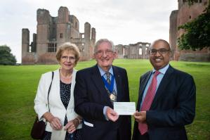 Former Mayor of Kenilworth Michael Coker and his wife Janice present a cheque for £3,000 to the Dean of Warwick Medical School Sudhesh Kumar to help with diabetes research.