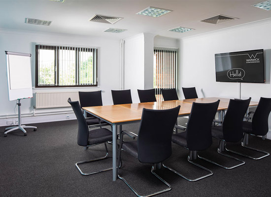 Table and seating in small meeting room Coventry