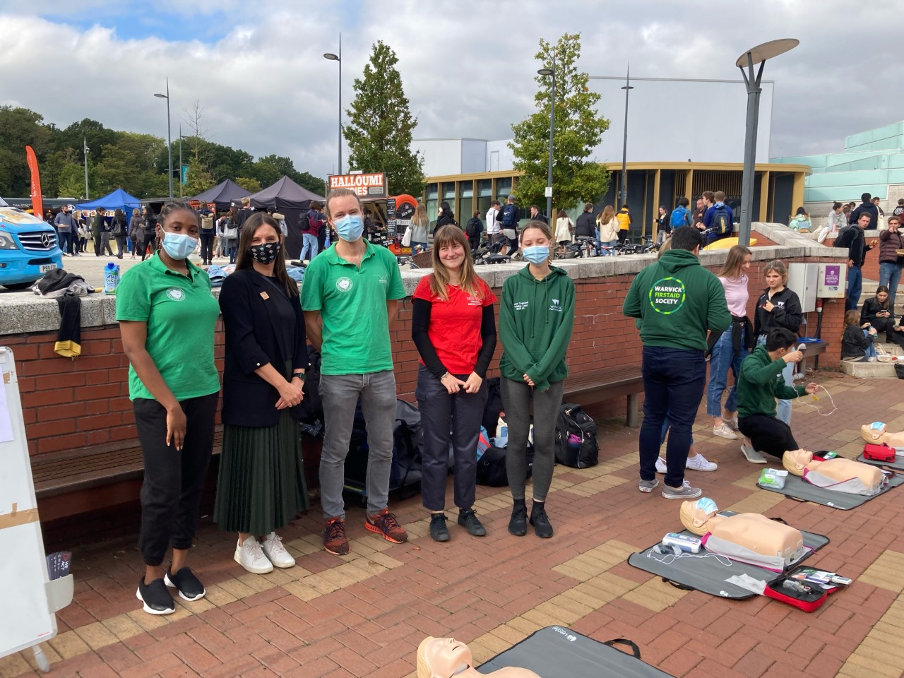 Photo of Jade Wilmot (Resuscitation for Medical Disciplines Society) and their team, Dr Jane Bryan (Community Values Education Programme) and representatives from the Warwick Life Saving Society and the Warwick First Aid Society at the event
