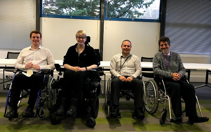 A picture of three participants of the Wheelchair Challenge sitting in wheelchairs and Access Auditor, Jenny Wheeler second in from the left.