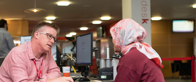 A member of our helpdesk staff advising a student