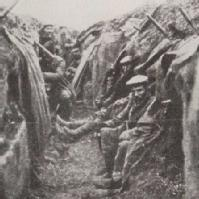 Soldiers sitting in trench