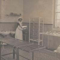 Nurse in early 20th century hospital