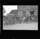 A group pose with their cycles outside a hotel