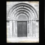 Ornate arch above wooden doorway