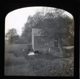 Brick watermill with trees and field