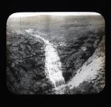 Waterfall flowing into crevasse