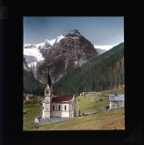 Small church with mountain in background