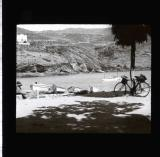 Woman sitting by river with bike