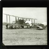 Kuomintang aeroplane, with members of military sitting in shade of the aircraft's wings