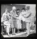 Busily serving out rations. Lady Louis Mountbatten, Lady F. Forbes, Lady Gisborough, the Right Hon. Mrs E. Fitzgerald, Captain Bundock, Captain Peebles Chaplin.