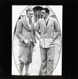 With the car fleet. Mr C.H. Reed (left) discussing with Lord Airlie. Working at Transport Ministry's Car Park.