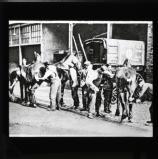 Clerks grooming L.M.S. horses