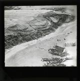 The first Spanish landing on Cebadilla Beach on Sept. 8th 1925, an air view showing scouts climbing the sandhills, and troops disembarking from the boats, on two of which may be seen turreted tanks.