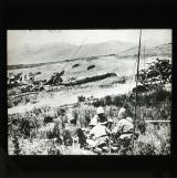 French artillery in the Hill country north of Taza: a battery of Howitzers in the territory of the Branes – showing right foreground the wireless apparatus by which communication is maintained with headquarters.