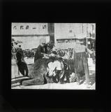 This horrible photograph shows the corpse of a rebel being fastened to the back of a camel by French troops in Damascus prior to a ghastly parade of a couple of dozen such corpses through the main street of that city as a warning to the people
