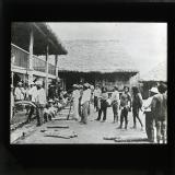 In the U.S. there has been considerable commotion over rubber. Crude rubber gathered by Indians in the forest wilds of Eastern Peru being weighed at a jungle station. America might invest capital for the development of the industry in South America.