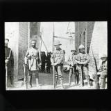 British and Indian troops on guard at St Stephan's Gate, above the Indian's head is the Arab motto 'Strength is Unity, and Unity is obtained by wisdom'