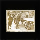 British soldier searching haycart