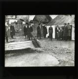 'Photograph showing a destroyed farm and the fowl-shed in which the family is now living'