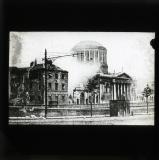 'The Four Courts as it appeared during the bombardment by National Troops. In the photograph a shell is seen exploding on the building.', 1922