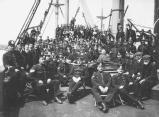 Photograph taken on board the Federation's depot ship Lady Jocelyn, during the Liverpool Strike of 1911, showing free labour workers waiting to be drafted into the docks, and accompanied by a police escort [MSS.367/TSF/12/4/1]