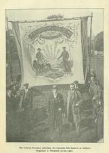 [1918] The General Secretary unfurling two banners at Sudbury