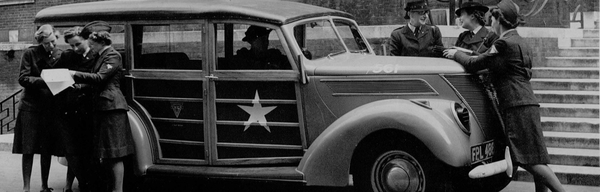 Image of uniformed YWCA officers with large car
