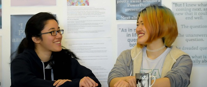Two students talking in the Wolfson Research Exchange