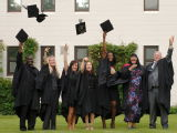 graduates, hats in air