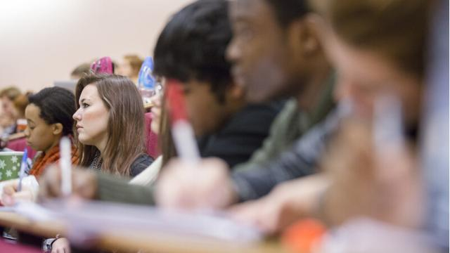 Students take notes in a lecture given by one of the University of Warwick's many experts