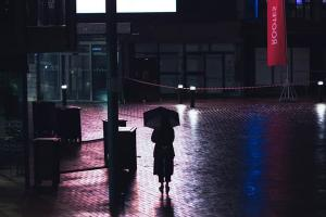silhouette_of_student_in_rain_with_umbrella_at_night.jpg