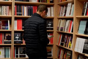 student_looking_at_books_in_our_bookshop.jpg