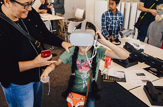 Volunteer doing VR activity with a child