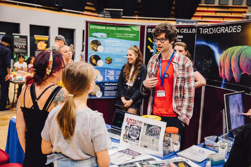 Students engaging people at a family day